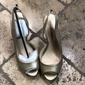 Brand new gold heels